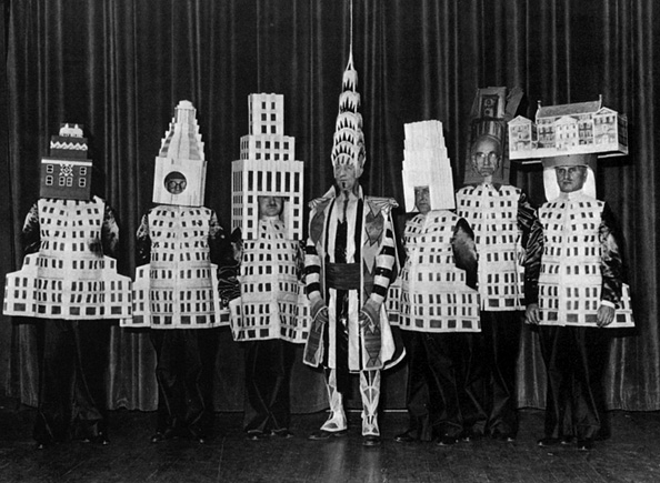 People wearing building costumes