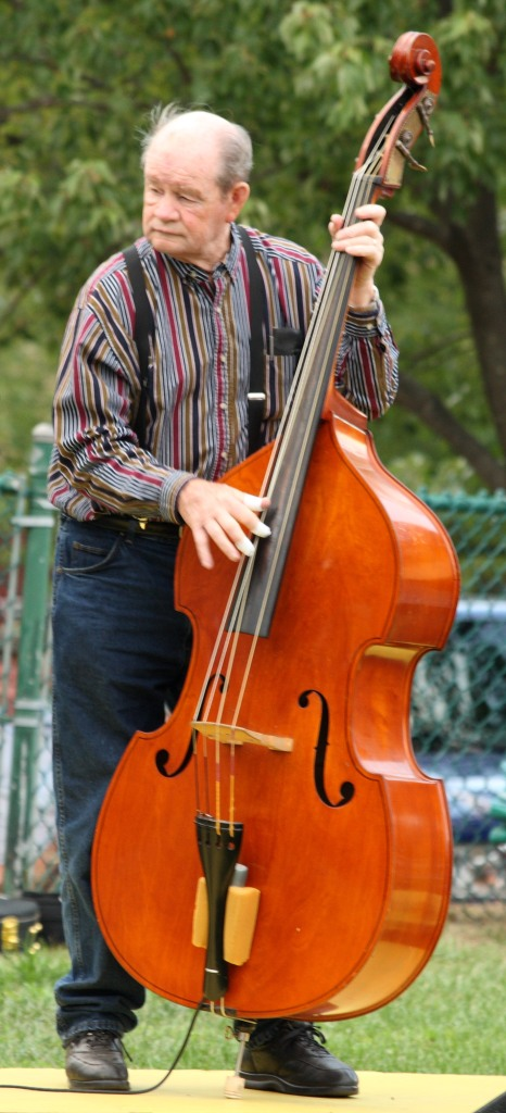 man playing stand up bass