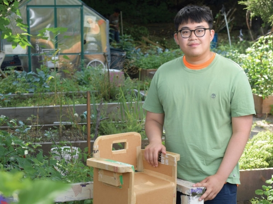 College student in a community garden