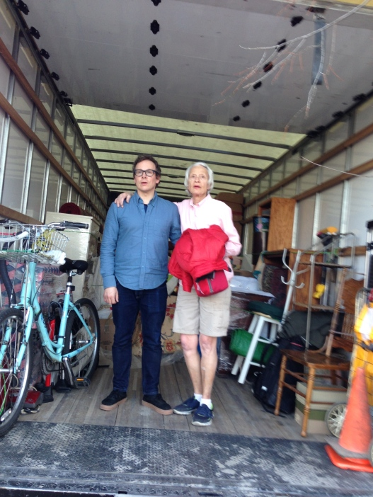 Man and woman standing in moving truck