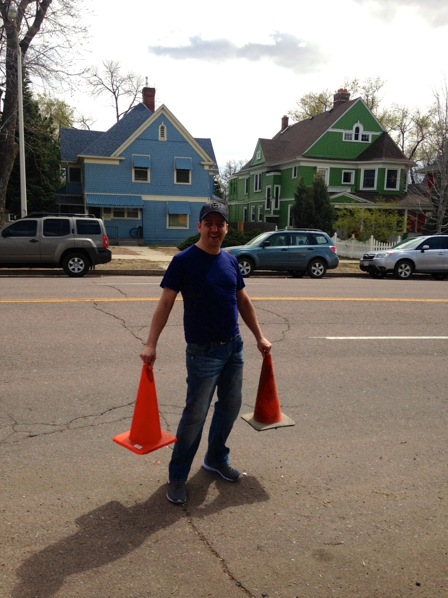 Man with orange traffic cones