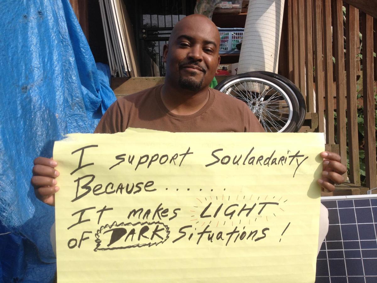 Carlos supports Soulardarity sign
