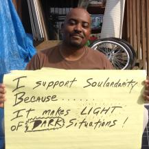 Carlos supports Soulardarity sign