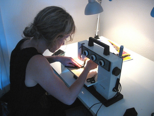 Blonde woman with sewing machine