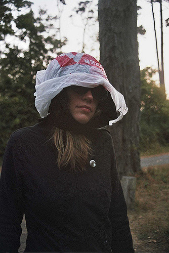 Woman outdoors with plastic bag hat