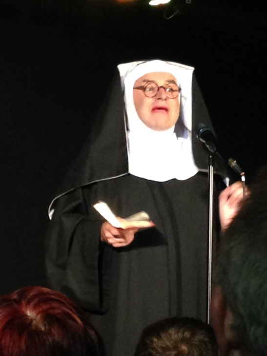 Drag nun with round glasses