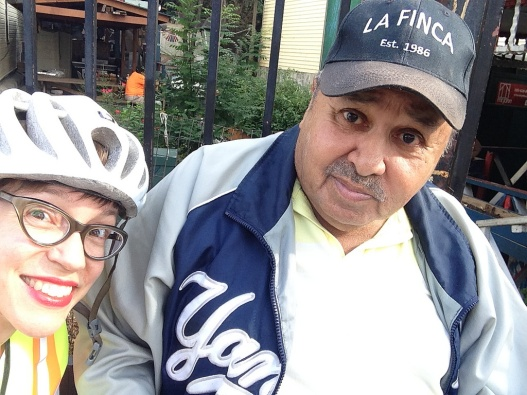 Woman in bike helmet next to man in baseball cap